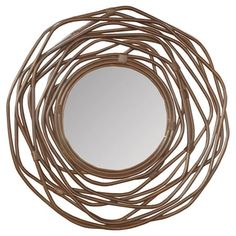 Showcasing an openwork rattan frame and round silhouette, this eye-catching mirror brings lovely appeal to your entryway or master suite.