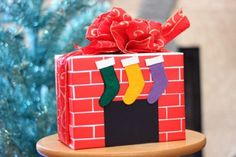 Tired of the same old holiday wrapping paper? Wrap you gift in a brick-pattern paper and make it look like a small fireplace.