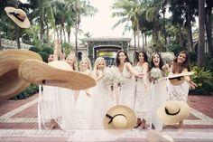 Breakers Palm Beach wedding. Tossing hats, bridesmaids wearing white, fun bridesmaid portrait -photo: Sarah DiCicco