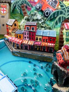 Sara Drake - Portofino detail from a larger 3D illustrated map of Italy - papier mache, acrylic paint, balsa wood and mixed media. 2014