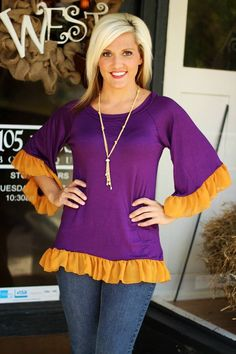 """Rah Rah Ruffles"" Top $29.99.  Shown in Purple/Gold.  Great for LSU Tiger fans!  S, M, L.  Available at 105 West Boutique in Abbeville, SC.  (864) 366-WEST.  Shipping $5."