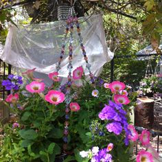 Beaded hanging baskets (found at Lowes for $7.00 including plants!!) Great way to add some sparkle & bling to your garden.