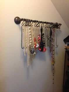 DIY necklace holder for E.  Need to figure out how to do it with command hooks (renters' best friend).