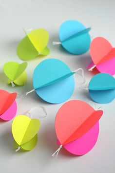 DIY: Colorful Paper Ornaments. You could also make a garland of it.