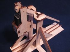 Desktop Trebuchet via Kickstarter… moments like this are when I feel left out on not getting a piece of the action ;)