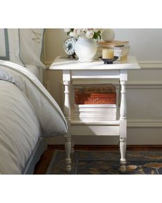 A simple and compact nightstand holds all of your nighttime necessities. Buy it here: http://www.bhg.com/shop/pottery-barn-emma-spindle-bedside-table-p505c378882a71c80fdfdce9c.html?socsrc=bhgpin102812pbendtable