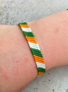 The Irish Flag Friendship Bracelet by LAWSeME on Etsy, $5.00. It's real name is The Horan.
