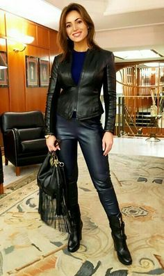 Amateur in leather jacket pants boots outfit
