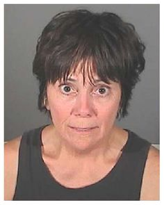 "Actress Joyce DeWitt who played Janet on the 1970s TV show ""Three's Company,"" was arrested by California cops in July 2009 and charged with suspicion of drunk driving. El Segundo police stopped DeWitt, 60, after she allegedly drove around a barricade at an annual city July 4 fireworks show. After failing a series of field sobriety tests, she was taken to the El Segundo jail where she posed for the above mug shot before being cited and released."