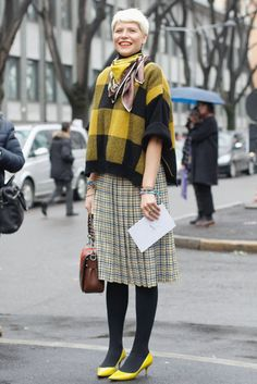 Street Style at Milan Fashion Week Fall 2013 Elisa Nalin mixed plaids for a quirky play on ladylike.