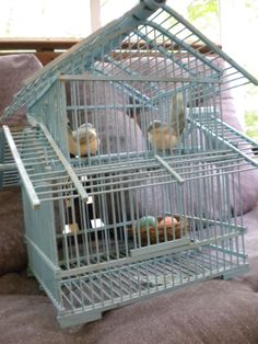 i am so in love with this antique blue bamboo cage!