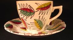 Kathie Winkle - Jester Cup & Saucer -Broadhurst, England Pottery.