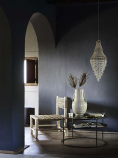 Dark walls styled with white items.