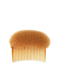 DIY this, with cheap comb and dish scrubbie. make poofs in hair with this (: