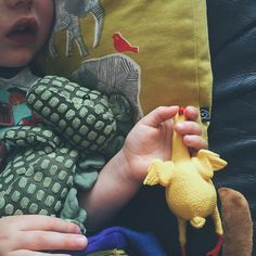 I hate it when the littles are poorly he's running a fever won't eat and the only things that are keeping him happy when he's awake are Mr Dinosaur having his back rubbed and holding this small rubber chicken!