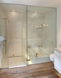 Shower combined with tub done well. Dos Architects  I'd end the glass near the tub but I love the area