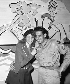 Rita Hayworth with brother Sgt. Eduardo Cansino at the Hollywood USO, 1943 ~