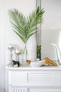 Exclusive: Tour Margo & Me's Hollywood Haven | // Palm fronds and silver and gold details atop a fireplace mantel.