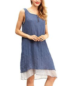 Buttons structure the laid-back silhouette of this fluttering dress, and a lightweight cotton blend ensures lasting comfort.