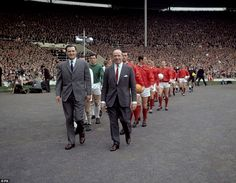 The two managers, Leicester City's Matt Gillies (l) and Manchester United's Matt Busby (r), lead their teams out at Wembley before the FA Cup final in 1963