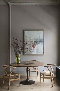 Colorful art in a gray dining room