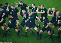 Richie McCaw of the New Zealand All Blacks leads his team as they preform a haka wearing their World Cup winners medals