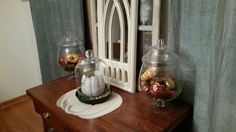 Fall Decor ! Pumpkins. I like to change out my apathicary jars with the season. We still are reusing items from our wedding. The cloche contains a book print deco paged pumpkin.