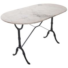 French 1920's White Marble Top & Iron Bistro Table | From a unique collection of antique and modern tables at http://www.1stdibs.com/furniture/tables/tables/