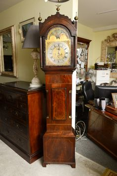 "1stdibs | Superb Mahogany Grandfather Clock | case is flamed mahogany with satinwood inlay to the front |  day grandfather clock with a brass face it strikes on the half hour and the hour, it also has the second small hand which goes constantly | UK, c.1800 | 18""w x 9""d x 7'6""h"