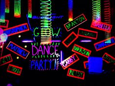 Glow party decorations, black paper with fluorescent paint and fluorescent duct tape trim