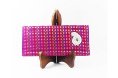 Shopibiz presents new designer clutches. Made from ruby brocket fabric with red, green, golden polka dots. This slim clutch is perfect to carry your wallet; phone, keys and cards etc. and a few more essentials. A small zip pocket and two pleated pockets inside the clutch. It's great for party or any occasion. Measures 10.5 inches wide and 5.5 inches high and is padded with interfacing. The pleats inside clutch give a nice pretty detail and make for lots of space too.