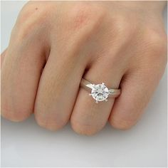 Gold engagement ring with heart shape inside by RodeoGoldCom