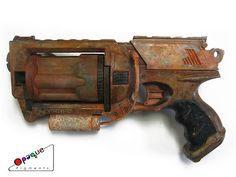 "Customized and hand painted Nerf Maverick, designed with a washed rust paint job, inspired by the video game ""Enslaved: Odyssey to the West."""