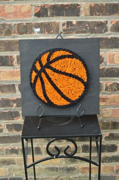 Perfect addition to any sports fan decor! This basketball measures at 12x12 on stained ebony wood! This item is READY TO SHIP! This string art comes with a sawtooth hanger for convenient hanging. Im open to making just about anything and in different sizes! Please message me if youd like