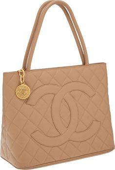 b100ed9da50f Chanel Beige Caviar Leather Medallion Tote Bag with Gold Hardware Chanel  Tote, Chanel Handbags,
