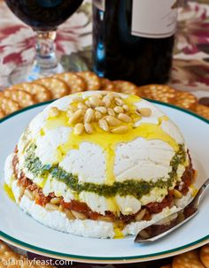 Goat Cheese, Pesto and Sun-Dried Tomato Terrine - Looks very fancy but it's very easy to make! And the flavors of goat cheese, pesto, sun-dried tomatoes and pine nuts are fabulous together! *(Sub goat cheese for something edible)