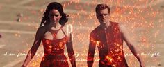"Katniss and Peeta on Chariot ride into the City Circle. flaming clothes. fire #gif - ""I am floored by how breathtaking we look. In the deepening twilight, the firelight illuminates our faces."" Hunger Games"