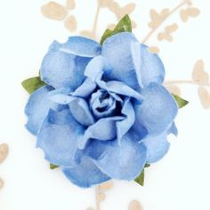 "Brides, meet our most popular DIY Project supply! These gorgeous handmade flowers measure 1.5"" across, and are made of deluxe heavyweight crafting paper. Mix and match colors to create a custom look,"