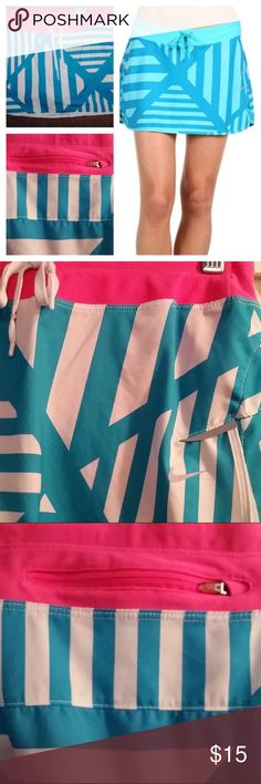 Nike Dri-Fit Athletic Running Skort - M Nike Running Turquoise / White / Pink Skirt /Skirt  Women's Nike Dri-Fit Running Skort.  Lightweight Skirt, Stretchy Elastic Waistline w/Drawcords  Details: Women's size medium Turquoise / White Geometric Stripes Built in shorts are pink color  Reflectors  Zippered pocket for essentials Dri-fit and mesh vented sides Waist measures 15 inches across front Length measures 11.5 inches External drawstring Condition:  Excellent pre-owned condition Nike…