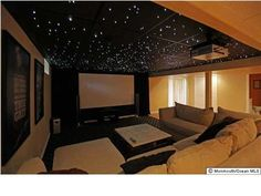 "Enjoy your own movie theater w/ 112"" screen and star light lighting system in this unique basement"