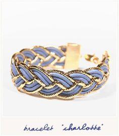 Un bracelet pop et shiny créé par les deux jolies designers de Cailles de Luxe. Des cordons de cuir lavende et or, tressés et tenus par un fermoir doré à lor fin 24 carats.