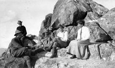 A party of hikers enjoys their smoking pipes and a laugh on Crown Mountain, North Vancouver. Photo circa 1920 taken by Franklin Walter Hewton, courtesy the Vancouver Archives.