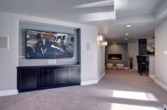 The basement family room features a recessed tv wall for large screen tv. The cabinets hide all the electronic equipment.