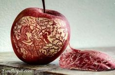 Snow White carved in apple.