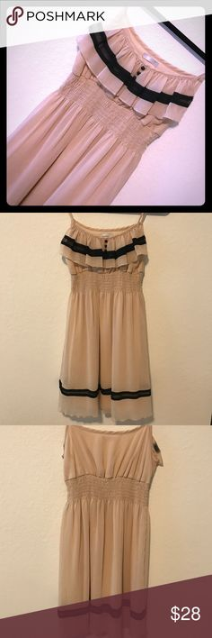 BEIGE & BLACK DRESS Beige and black dress. Spaguetti straps. Chiffon fabric. No rips, holes or stains. Elastic waist. Item #51.                                      💗Condition: Excellent used condition 💗Smoke free home 💗No trades, No returns 💗No modeling  💗Shipping next day 💗OPEN TO reasonable OFFERS  💗BUNDLE and save more 💗All transactions video recorded to ensure quality. Dresses Midi
