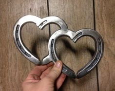 Items similar to Two Hearts One Love, 2 engraved intertwined hearts made from real horseshoes. Wedding gift or anniversary on Etsy Zwei Herzen eine Liebe HUFEISENherz Western von BlacksmithCreations Welding Art Projects, Welding Crafts, Metal Art Projects, Diy Welding, Blacksmith Projects, Horseshoe Projects, Horseshoe Crafts, Horseshoe Art, Horseshoe Wedding
