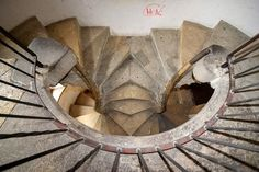 """The stairs split and rejoin several times as they circle upward to the top, and has often been interpreted as a symbol of eternity. Graz people call it the """"stairs of reconciliation"""" for if you go separate ways, you will ultimately reunite. Stairs Architecture, Architecture Details, Interior Architecture, Painted Stairs, Wooden Stairs, Take The Stairs, Under Stairs, Stair Slide, Building Stairs"""