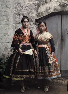 Debutantes of Lagartera stand in a doorway. Spain. traditional costume. autochrome