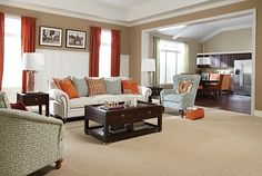Orange and teal living room topped off with Comfortably Classic - Lamp Light Mohawk Carpet. Beautiful! flacksflooring.com #comfyliving