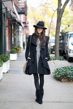 coat is by Christian Siriano.  The dress is Isabel Marant. The fur bag is by Theory.  Her boots are by Plomo
